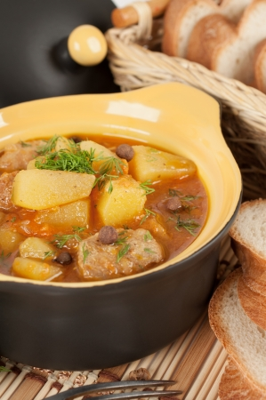 Stewed potatoes with meat in a ceramic pot  Stock Photo