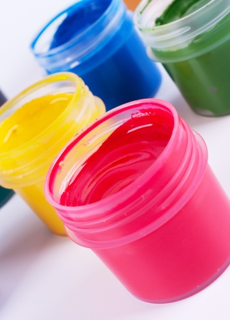 saturated: Jars with colored gouache  Closeup