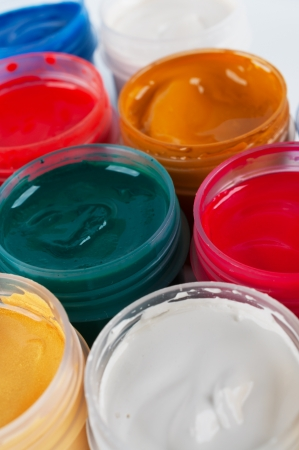 Jars with colored gouache  Closeup  photo