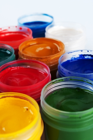 saturated color: Jars with colored gouache  Closeup