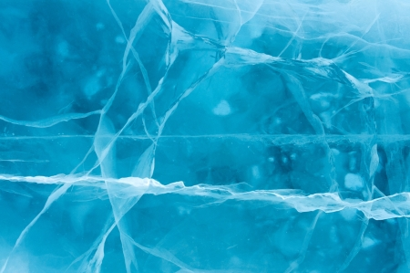 Network of cracks in thick solid layer of ice of a frozen river
