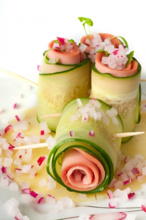 Cucumber rolls with pate and radishes