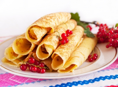 Delicious pancakes with red currant  On a round plate