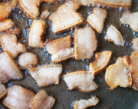 greaves: Fat fried in a pan  Best Ukrainian snack - greaves  Stock Photo
