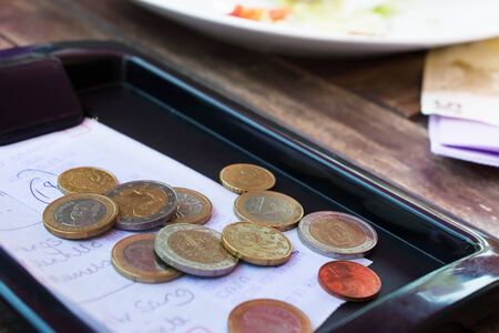 Euro coins on cash receipt from the restaurant
