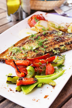 Dorado fish fillet with vegetables on the grill  photo