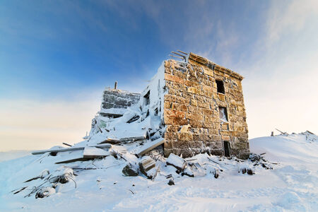 Destroyed a three-story building in the snow Stock Photo - 24471196