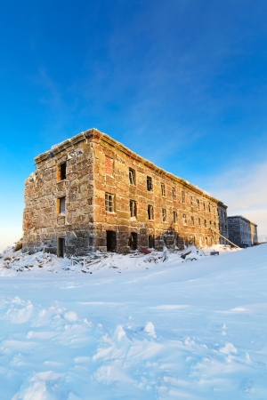Abandoned three-story building in the snow  Stock Photo - 24471195