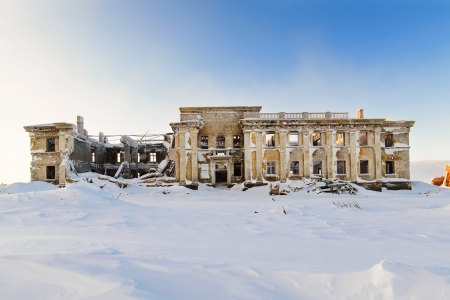 The abandoned two-story building  Winter snow