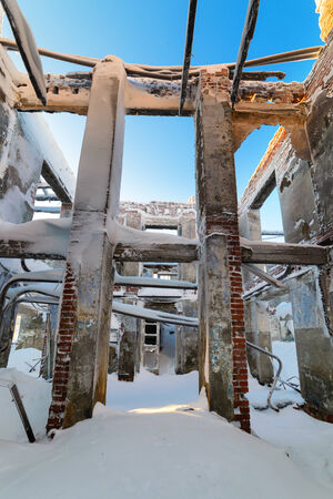 Snowy skeleton of the destroyed building photo