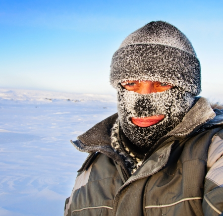 Portrait of a man in a cap and a ski mask  Winter in frost  Archivio Fotografico