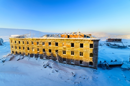 Abandoned three-story building in the snow  Stock Photo - 25373696