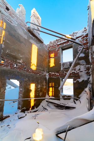 The abandoned two-story building  Winter snow Stock Photo - 25320480