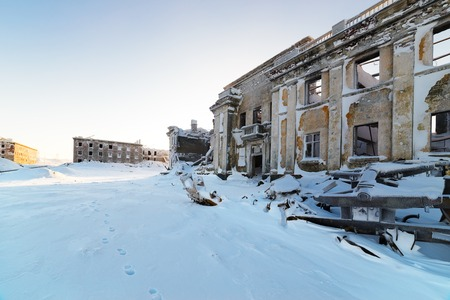 The abandoned two-story building  Winter snow Stock Photo - 25406645