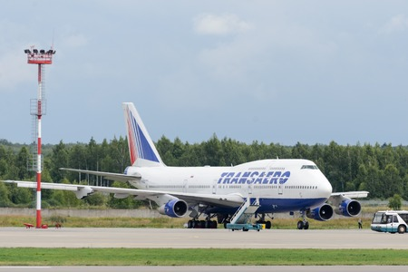 DOMODEDOVO, RUSSIA - JULY 20  Aircraft operated by Transaero Airlines, pending repair of the engine in Moscow airport Domodedovo on July 20, 2013  The company in its fleet has 21 aircraft Boeing-747