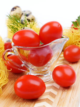 Glass Gravy boat with cherry tomatoes  photo