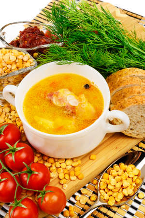 Pea soup with bacon  In white ceramic cup  Decorated with dill and cherry tomatoes  photo
