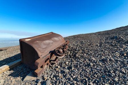 Abandoned mine trolley on the hillside  photo