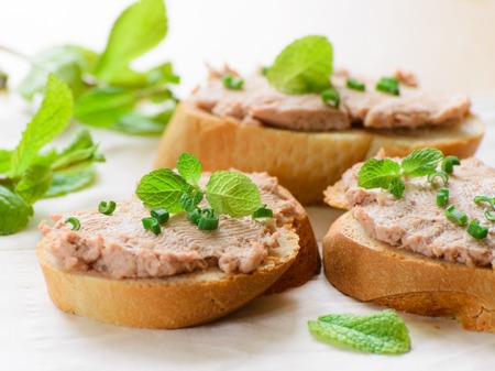 Sandwiches with paste and green onions  Served with mint sprigs