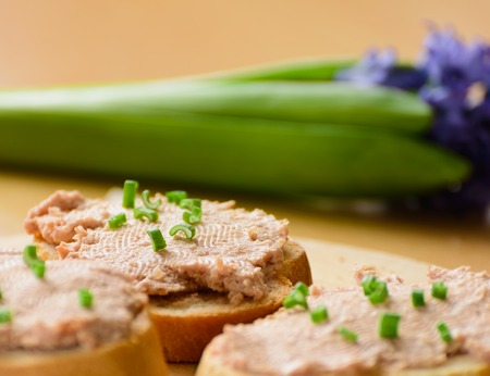 Sandwiches with meat pate  Decorated with green onion rings
