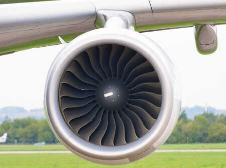Jet engine aircraft under the wing of the aircraft. Front view. Stock Photo