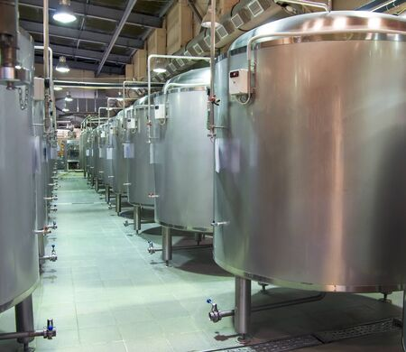 microbrewery: Steel tanks in which brewing beer at the brewery. Stock Photo