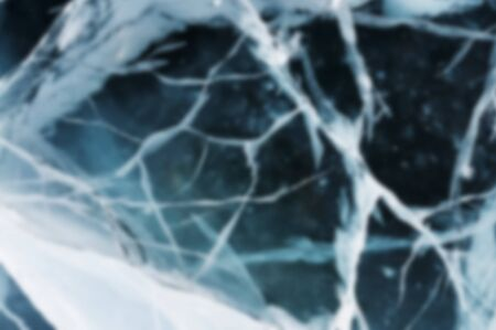 cracks in ice: Abstract Blue river ice with large cracks. Deep blur.