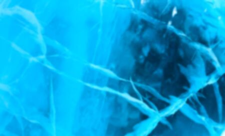 frosty: Abstract Blue river ice with large cracks. Deep blur.
