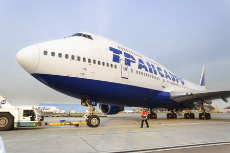 to exist: MOSCOW, RUSSIA - SEPTEMBER 26, 2014: Boeing 747 Transaero towed to the runway. Transaero Airlines has ceased to exist in 2015.