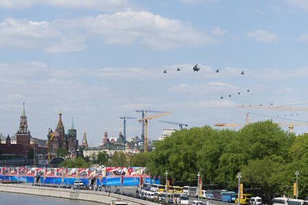 may fly: MOSCOW, RUSSIA - MAY 07, 2016: Helicopters fly over Red Square. Dress rehearsal of the Victory Day parade on Red Square.
