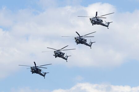 may fly: MOSCOW, RUSSIA - MAY 07, 2016: Formation of the Russian Air Force Mi-28 Havoc attack helicopter fly over Red Square. Dress rehearsal of the Victory Day parade on Red Square.