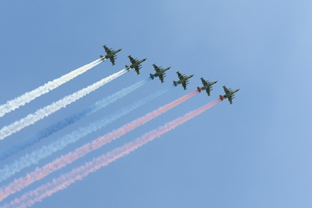 may fly: MOSCOW, RUSSIA - MAY 07, 2016: The Soviet attack aircraft Su-25 Frogfoot produced a beautiful smoke three colors of the Russian flag fly over Red Square. Dress rehearsal of the Victory Day parade on Red Square.