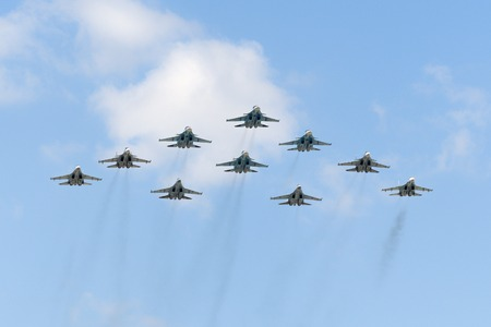 may fly: MOSCOW, RUSSIA - MAY 07, 2016: The group of Russian fighters fly over Red Square. Dress rehearsal of the Victory Day parade on Red Square.