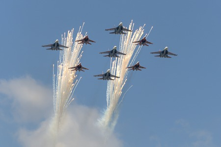 may fly: MOSCOW, RUSSIA - MAY 07, 2016: Salute Aerobatic team Swifts and Russian Knights on the fighters MiG-29 and Su-27 fly over Red Square. Dress rehearsal of the Victory Day parade on Red Square.