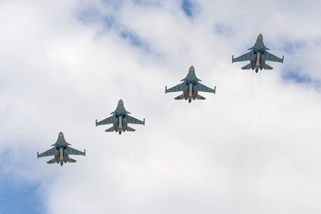 may fly: MOSCOW, RUSSIA - MAY 07, 2016: Sukhoi Su-34 Fullback twin-seat fighter-bomber aircrafts fly over Red Square. Dress rehearsal of the Victory Day parade on Red Square.