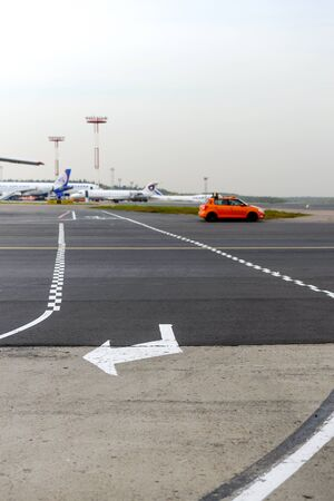 aerodrome: MOSCOW, RUSSIA - SEPTEMBER 26, 2014: Aerodrome layout. The intersection of the taxiway for airplanes and tracks for road transport.