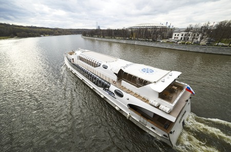 excursions: Moscow, Russia, April, 22, 2016. Modern Radisson pleasure craft make excursions across Moscow river all year round. In the spring, cloudy day, the poor light.