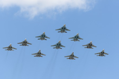 mig: MOSCOW, RUSSIA - MAY 07, 2016: The group of Russian fighters fly over Red Square. Dress rehearsal of the Victory Day parade on Red Square.