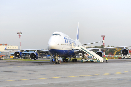boeing 747: MOSCOW, RUSSIA - SEPTEMBER 26, 2014: Boeing 747 Transaero waiting for boarding. Transaero Airlines has ceased to exist in 2015.