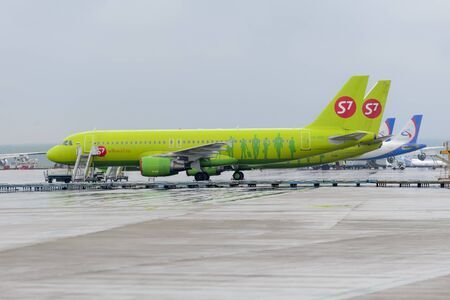 MOSCOW, RUSSIA - MAY 19, 2016: Airbus A320 S7 Airlines in the aircraft stands of the international airport Domodedovo.