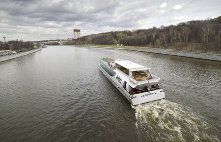 pleasure craft: Moscow, Russia, April, 22, 2016. Modern Radisson pleasure craft make excursions across Moscow river all year round. In the spring, cloudy day, the poor light.