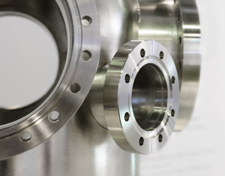 Several thick metal flange mounted on the metal casing. Fine metal, stainless steel. Stock Photo