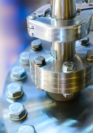 shiny metal: Flanged vacuum equipment. Shiny metal surface. A metal surface treated.