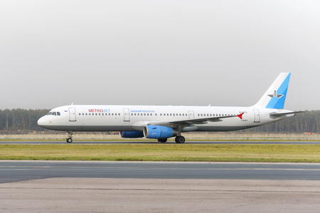 explosion engine: MOSCOW, RUSSIA - SEPTEMBER 26, 2014: Airbus MetroJet Airlines A321 makes taxiing on the runway Domodedovo International Airport. As a result of the terrorist attack that plane was blown up over the Sinai Peninsula 31 October 2015 Editorial