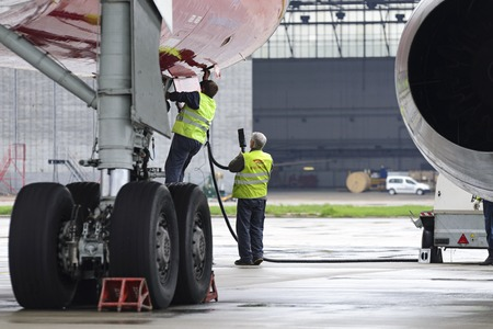 out of work: MOSCOW, RUSSIA - MAY 19, 2016: Aircraft  Tupolev-204 Red Wings airline in the parking lot of the international airport Domodedovo. Service engineers carried out work on the preparation of the aircraft for the flight.