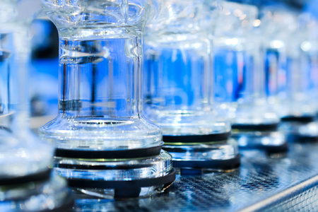 extractor: Abstract background with blue glass tubes. Detail of a Soxhlet extractor. Chemical laboratory equipment.