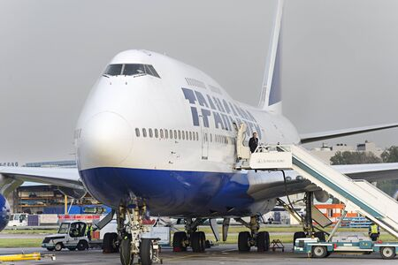 ceased: MOSCOW, RUSSIA - SEPTEMBER 26, 2014: Boeing 747 Transaero waiting for boarding. Transaero Airlines has ceased to exist in 2015.