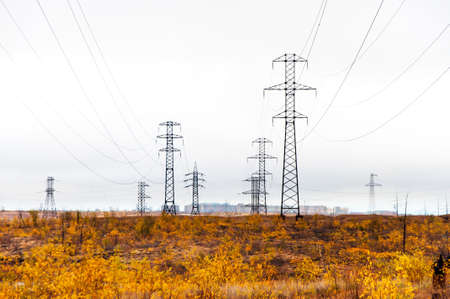 nasty: Supports high-voltage line. The tundra in the Arctic Circle, deep autumn. Its a nasty day. Stock Photo