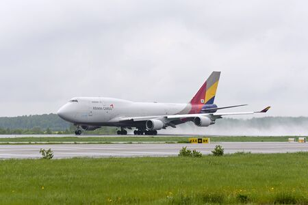 boeing 747: MOSCOW, RUSSIA - MAY 19, 2016: cargo airplane Boeing 747 Asiana Cargo take off to the runway at Domodedovo International airport.