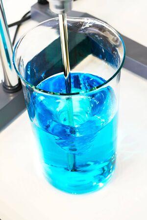 stirrer: The blue liquid was stirred in a glass laboratory stirrer.